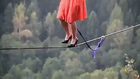very brave girl walking on rope with high heel
